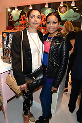 Left to right, JULIE BROMFIELD and her daughter singer DIONNE BROMFIELD at the launch of the Benefit Global Flagship Boutique at 10 Carnaby Street, London on 11th September 2013.