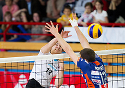 Domen Kotnik of Kamnik vs Gregor Ropret of ACH during volleyball match between Calcit Volleyball and ACH Volley in 4th Final Round of Radenska Classic League 2012/13 on April 16, 2013 in Arena Kamnik, Slovenia. (Photo By Vid Ponikvar / Sportida)