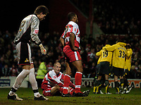 Photo: Jed Wee.<br /> Doncaster Rovers v Arsenal. Carling Cup. 21/12/2005.<br /> <br /> Doncaster players show their dejection as Arsenal celebrate.