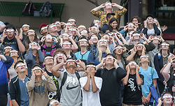 August 21, 2017 - Santa Fe, New Mexico, U.S. - Students at the Academy for Technology and the Classics charter school in Santa Fe watch the solar eclipse through cloudy skies. (Credit Image: © Eddie Moore/Albuquerque Journal via ZUMA Wire)