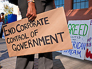 14 OCTOBER 2011 - PHOENIX, AZ:   A marcher arrives at the beginning of the Occupy Phoenix march in Phoenix, AZ. About 300 people participated in the Occupy Phoenix march through downtown Phoenix Friday evening, Oct. 14. The march was the first event in the Occupy Phoenix protests which start with the occupation of Cesar Chavez Plaza, a large square in downtown Phoenix.  PHOTO BY JACK KURTZ