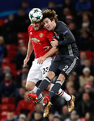 Manchester United's Luke Shaw (left) and CSKA Moscow's Mario Fernandes battle for the ball during the UEFA Champions League match at Old Trafford, Manchester.