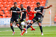 Blackpool forward Armand Gnanduillet (21) is tackled by Wimbledon midfielder Tom Soares (19)  during the EFL Sky Bet League 1 match between Blackpool and AFC Wimbledon at Bloomfield Road, Blackpool, England on 20 October 2018.