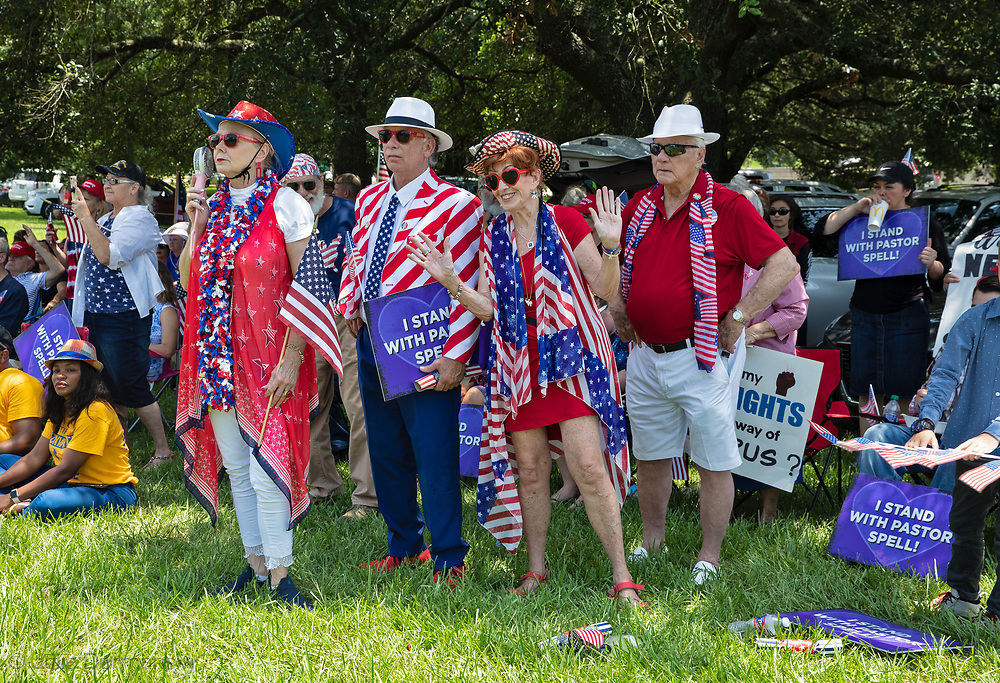 """People at a """"Save America Rally"""" in Baton Rouge on the 4th of July across the street from the Governor's Mansion where about 200 gathered. The 4th of July rally was organized by Jeff Crouer, Mimi Owens and Woody Jenkins, chairman of the executive committee for the Republican Party in East Baton Rouge Parish. Rev. Tony Spell of Life Tabernacle Church who has held church services in defiance of a stay-at-home order throughout the pandemic was one of the speakers. He an other speakers expressed their displeasure of being told to wear a mask to prevent the spread of Covid-19 and the removal of confederate monuments."""