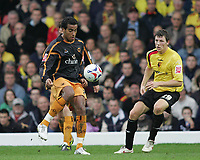 Photo: Lee Earle.<br /> Watford v Wolverhampton Wanderers. Coca Cola Championship. 29/10/2005. Wolverhampton's Tom Huddleston (L) clears ahead of Darius Henderson.