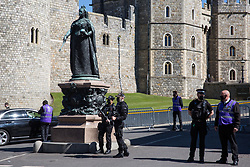 Windsor, UK. 17th April, 2021. Armed Thames Valley Police officers and community wardens from the Royal Borough of Windsor and Maidenhead stand guard outside Windsor Castle on the day of the funeral of the Duke of Edinburgh. The funeral of Prince Philip, Queen Elizabeth II's husband, is taking place at St George's Chapel in Windsor Castle, with the ceremony restricted to 30 mourners in accordance with current coronavirus restrictions.