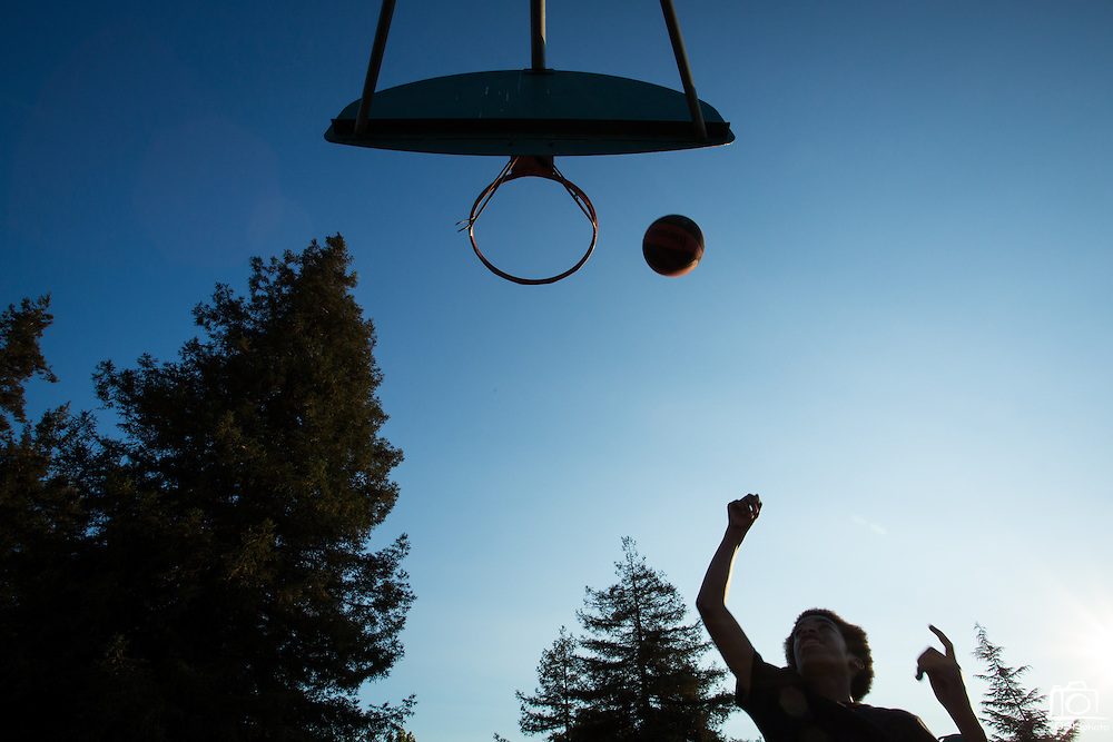 Keandre Manning, 13, of Milpitas plays basketball with friends during the 6th Annual District 4 National Night Out Resource Fair and Movie Night at Northwood Park in San Jose, California, on August 6, 2013. (Stan Olszewski/SOSKIphoto)