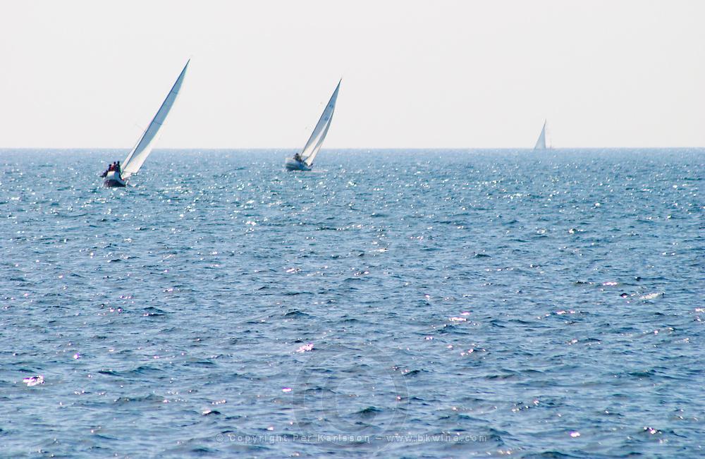three Sailing boats at sea outside Bandol Cote d'Azur Var France