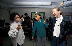 Girls dancing at youth club Bradford Yorkshire UK