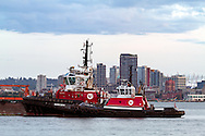 Seaspan Raven and Seaspan Hawk Tug Boats in Burrard Inlet. Photographed from the Kings Mill Walk Dog Park (Spirit Trail) in North Vancouver. Buildings in the background are in downtown Vancouver.