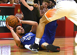 October 21, 2017 - Los Angeles, California, U.S. - Los Angeles Clippers guard Austin Rivers (25) scrambles for the ball against the Phoenix Suns in the first quarter during an NBA basketball game at the Staples Center on Saturday, Oct 21, 2017 in Los Angeles. .(Photo by Keith Birmingham, Pasadena Star-News/SCNG) (Credit Image: © San Gabriel Valley Tribune via ZUMA Wire)