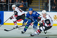 KELOWNA, BC - SEPTEMBER 29: Brock Boeser #6 of the Vancouver Canucks back checks Laurent Dauphin #12 of the Arizona Coyotes during first period at Prospera Place on September 29, 2018 in Kelowna, Canada. (Photo by Marissa Baecker/NHLI via Getty Images)  *** Local Caption *** Laurent Dauphin;Brock Boeser;Lawson Crouse