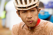 Another mud-caked face during stage 2 of the 2014 Absa Cape Epic Mountain Bike stage race from Arabella Wines in Robertson, South Africa on the 25 March 2014<br /> <br /> Photo by Greg Beadle/Cape Epic/SPORTZPICS