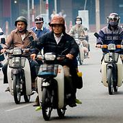 Early morning motorcycle traffic on Hanoi street (Hanoi, Vietnam - Nov. 2008) (Image ID: 081117-0651572a)