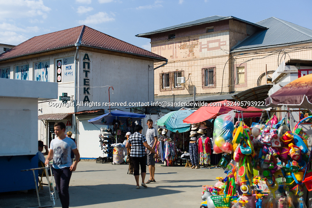20150826 Bendery, Bender, Transnistria, Moldova. A pharmacy and market showing a typical market day in the center of Bendery.