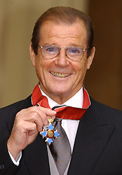 File photo dated 09/10/03 of Sir Roger Moore with his knighthood at Buckingham Palace. Sir Roger has died in Switzerland after a short battle with cancer, his family has announced.