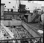 31/07/1962<br /> 07/31/1962<br /> 31 July 1962<br /> Oil drilling equipment arrives at North Wall, Dublin. Image shows view oil drilling machinery in the ships hold for Ambassador Irish oil.