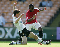 Photo: Paul Thomas.<br /> Port Vale v Bristol City. Coca Cola League 1. 23/09/2006.<br /> <br /> Jennison Williams (R) of Bristol gets tackled by George Pilkington.