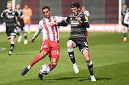 Stevenage defender Terence Vancooten (15) battles for possession with Crawley Town forward Ashley Nadeson (10) during the EFL Sky Bet League 2 match between Stevenage and Crawley Town at the Lamex Stadium, Stevenage, England on 1 May 2021.