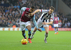 Leandro Bacuna of Aston Villa Battles for the ball with Jonny Evans  of West Bromwich Albion - Mandatory byline: Alex James/JMP - 23/01/2016 - FOOTBALL - The Hawthorns - Birmingham, England - West Brom v Aston Villa - Barclays Premier League