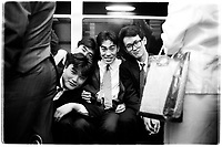 Salarymen on the Tokyo subway going back home after a night out, Tokyo Japan. 1987.