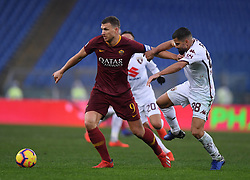 ROME, Jan. 20, 2019  AS Roma's Edin Dzeko (L) vies with Torino's Tomas Rincon (R) during the Serie A soccer match between AS Roma and Torino in Rome , Italy, Jan.19, 2019. AS Roma won 3-2. (Credit Image: © Alberto Lingria/Xinhua via ZUMA Wire)