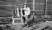 8706-08ACarpenter with his tool box. Newell South Dakota,