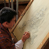 Asia, Bhutan, Thimpu. Student artist creating a tangkha at the National Institute for Zorig Chusum, or traditional arts and crafts.