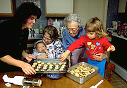 Four generations of the Jones family making Christmas cookies.  WesternSprings Illinois USA