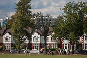 Riders and horses from a Brixton stables enjoy autumn sunshine in front of period Edwardian houses bordering Ruskin Park, on 11th October 2016, in London, England.