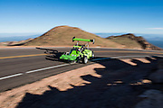 June 26-30 - Pikes Peak Colorado. Norm Meyer runs his car during practice for the 91st running of the Pikes Peak Hill Climb.