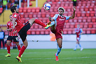 Devarn Green (14) of Scunthorpe United battles for possession with Zack Elbouzedi during the EFL Trophy match between Lincoln City and Scunthorpe United at Sincil Bank, Lincoln, United Kingdom on 8 September 2020.