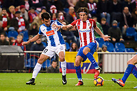 Atletico de Madrid's player Filipe Luis and RCD Espanyol player Hernan Perez during match of La Liga between Atletico de Madrid and RCD Espanyol at Vicente Calderon Stadium in Madrid, Spain. December 03, 2016. (ALTERPHOTOS/BorjaB.Hojas)