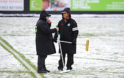 Groundsmen staff try to clear snow at the innocent New Lawn Stadium prior to kick-off - Mandatory by-line: Nizaam Jones/JMP - 02/01/2021 - FOOTBALL - innocent New Lawn Stadium - Nailsworth, England - Forest Green Rovers v Oldham Athletic - Sky Bet League Two