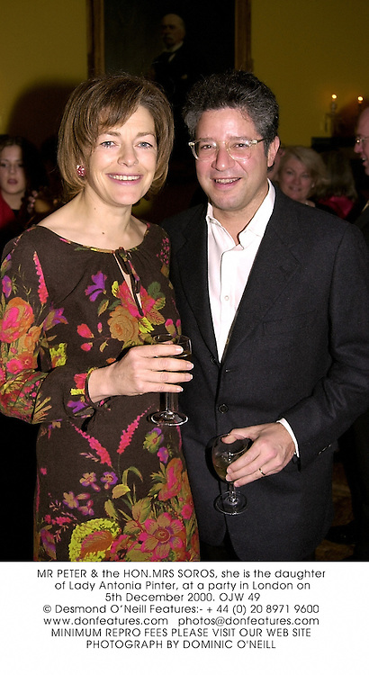 MR PETER & the HON.MRS SOROS, she is the daughter of Lady Antonia Pinter, at a party in London on 5th December 2000.OJW 49