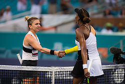 March 25, 2019 - Miami, FLORIDA, USA - Simona Halep of Romania & Venus Williams of the United States at the net after their fourth-round match at the 2019 Miami Open WTA Premier Mandatory tennis tournament (Credit Image: © AFP7 via ZUMA Wire)