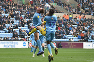 Coventry City defender Tom Davies  (5) heads the ball with Coventry City defender (on loan from Chelsea) Dujon Sterling (17) during the EFL Sky Bet League 1 match between Coventry City and Bristol Rovers at the Ricoh Arena, Coventry, England on 7 April 2019.
