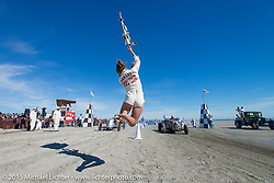 Flag girl gets the races going right from the start during the The Race of Gentlemen. Wildwood, NJ, USA. October 11, 2015.  Photography ©2015 Michael Lichter.