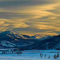 Lenticular clouds glow in a sunset over the Lamar Valley in Yellowstone National Park, Wyoming