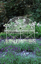 White iron seat and lavender maze with slate paths.
