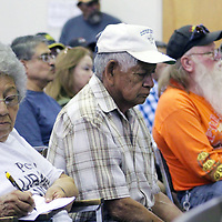 Marlene Johnson of Laguna Pueblo, who suffers from pulmonary fibrosis, takes notes during Saturday's Post '71 Uranium Workers Committee in Grants.