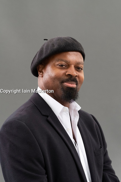 """Edinburgh, Scotland, UK; 17 August, 2018. Pictured; Ben Okri. In his book  """"The Magic Lamp"""" , Okri has collaborated with painter Rosemary Clunie to create a collection of twenty-five haunting stories , each accompanied by a dreamlike painting."""