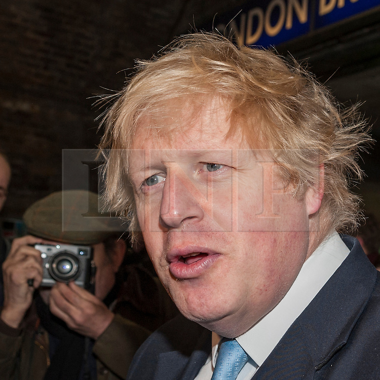 © Licensed to London News Pictures. 23/03/2015. London Bridge station, London UK. The Mayor of London, Boris Johnson, meets the media after joining London band, The Tailormade, to officially launch this year's Gigs busking competition and two brand new initiatives aimed at supporting and promoting busking and street performance in the capital and beyond.  The Tailormade are a three piece band from Ealing, made up of Jack Frimston, Matt Pickersgill and Aaron Murphy. Photo credit : Stephen Chung/LNP