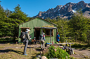 """Refugio Piedra del Fraile, Rio Electrico Valley. El Chalten, Santa Cruz Province, Argentina, Patagonia, South America. Hike the scenic Rio Electrico Valley to Refugio Piedra del Fraile (""""Stone of the Friar"""", 14.5 km round trip). From the refuge, a rewarding day hike visits Lago Pollone (8.5 km round trip with 320 m gain) beneath towering Cerro Fitz Roy and Aguja Pollone. Another path from the refuge ascends very steeply to Paso Quadrado (gaining 1340 m vertically in 8.4 km round trip) for a spectacular view south to Guillaumet, Mermoz, Fitz Roy, Cerro Torre, and Aguja Pollone (left to right). The last kilometer climbs up steep snow which could require crampons if icy. Views keep improving the higher you go."""