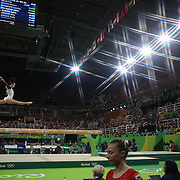 Gymnastics - Olympics: Day 2   Courtney McGregor #372 of New Zealand performing her routine on the Balance Beam during the Artistic Gymnastics Women's Team Qualification round at the Rio Olympic Arena on August 7, 2016 in Rio de Janeiro, Brazil. (Photo by Tim Clayton/Corbis via Getty Images)<br /> <br /> (Note to editors: A special effects starburst filter was used in the creation of this image)