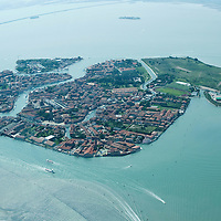VENICE, ITALY - JULY 07:   A general view of the Island of Murano seen during the Seawing  tour above Venice on July 7, 2011 in Venice, Italy. Seawings has started a new tour of Venice by seaplane, offering aerial views of the Venetian Lagoon and its historic islands, continuing a long history of seaplanes in Venice.