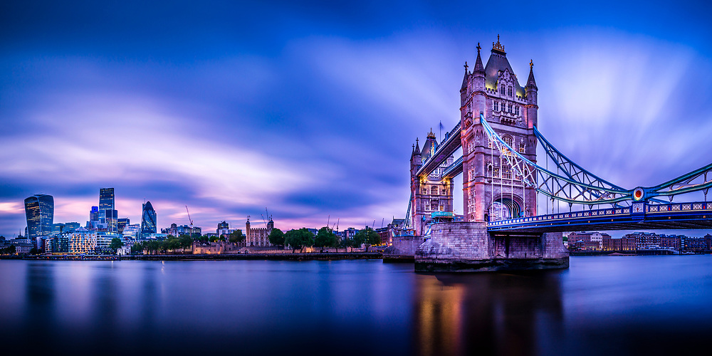 Long exposure panorama of the Tower Bridge and City of London at dusk