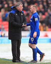 Everton's Wayne Rooney shakes hands with Everton manager Sam Allardyce as he is substituted off during the Premier League match at the bet365 Stadium, Stoke.