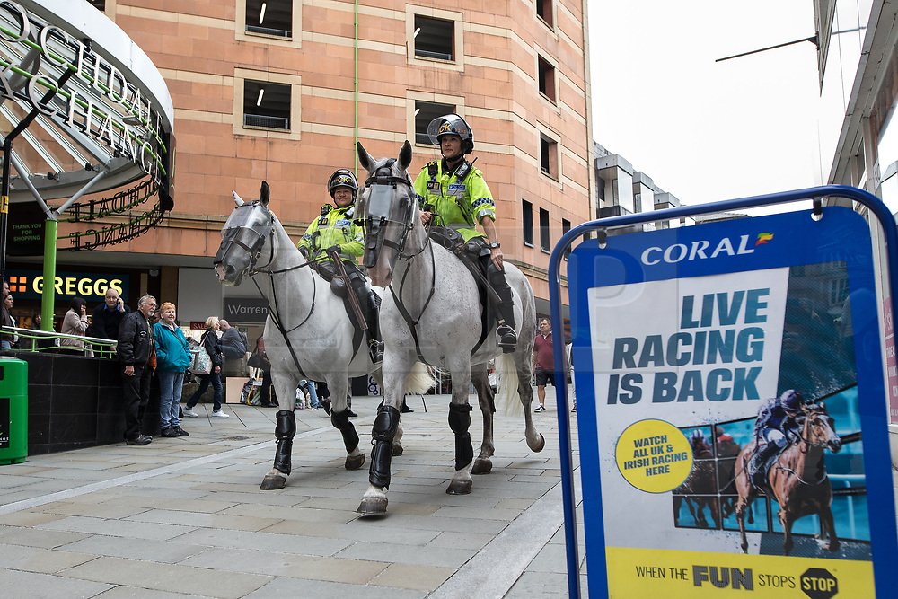 © Licensed to London News Pictures . 29/07/2017 . Rochdale , UK . Police from forces including Cheshire, GMP, West Midlands and North Wales in Rochdale Town Centre ahead of the demonstrations . Far-right street protest movement , the English Defence League ( EDL ) , hold a demonstration in Rochdale , opposed by anti-fascists , including Unite Against Fascism ( UAF ) . The EDL say they are demonstrating against the sexual grooming and abuse of English girls by Muslim men in Rochdale and against terrorism across the UK . Photo credit : Joel Goodman/LNP