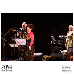 Led by Dónal Lunny, known internationally as the foremost catalyst for the renaissance of traditional Irish music, this ensemble is a unique collaboration honouring ancient Celtic and Maori music in a contemporary context...Lunny has assembled the leading lights of the traditional musical circles from Ireland and Aotearoa to meet, workshop and collaborate in New Zealand before joining the Festival to bring us this cutting edge show woven from strands of music, kapa haka dance, poetry, the NZ traditional instruments Taonga Puoro or 'singing treasures' and the age-old gaelic style of singing Sean Nos...Featuring NZ's vocalist Whirimako Black, Taongo Puoro master Richard Nunns joined by Horomona Horo, percussionist Riki Gooch (founding member of Trinity Roots) and multiple award winning Glenn Colquhoun, voted 'The Peoples Poet' in the Montana Awards...From Ireland, joining Donal Lunny is fiddler Nollaig Casey, singer Iarla O' Lionaird, harpist Laois.e Kelly, guitarist Steve Cooney, Uilleann piper Sean McKeon and Irish poet Cathal O Searcaigh.